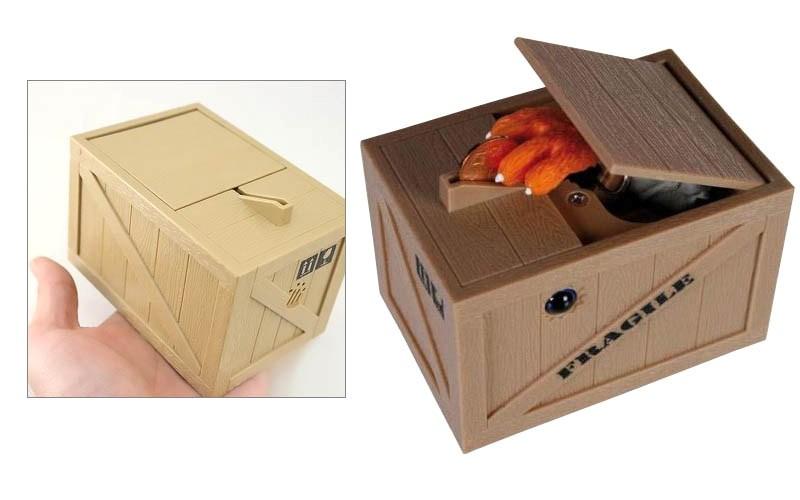 Κουμπαράς γάτα στο κουτί